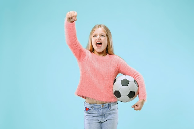 Fan sport teen player holding soccer ball isolated on blue