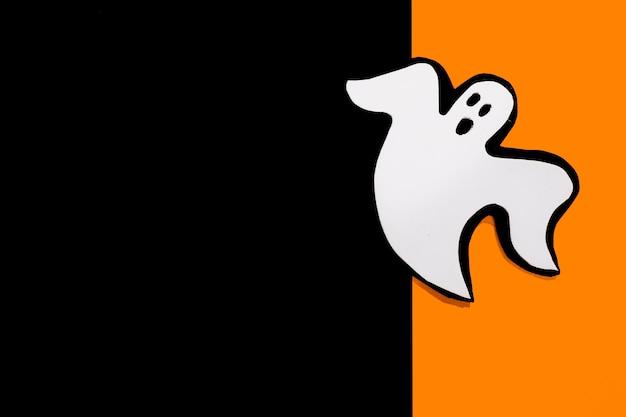 Fantôme d'halloween fait main sur papier orange