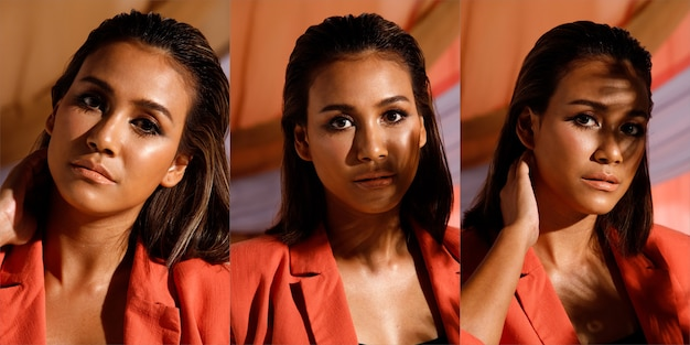 Fashion beauty india woman a des cheveux noirs courts et raides qui expriment une émotion. portrait d'une fille asiatique portant un costume de blazer rouge dans l'ombre du soleil de l'après-midi sur fond de vêtements pastel