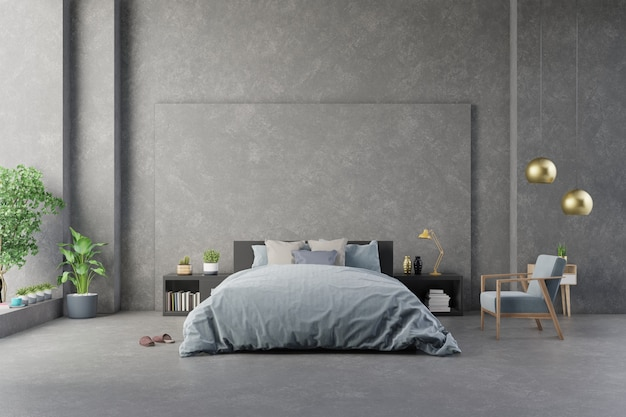 Fauteuil bleu foncé près du meuble et du lit avec draps dans le mur de béton intérieur de la chambre et les meubles modernes.