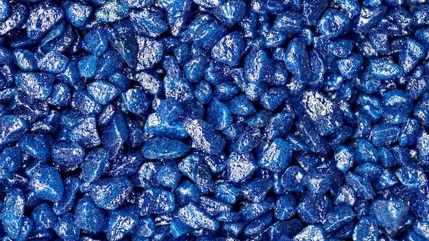 Faux motif de pierres précieuses bleues. pierres pailletées bleues pour la décoration de jardin