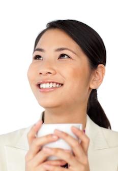 Femme d'affaires asiatique, boire du café