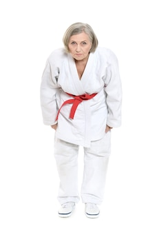 Femme aînée, dans, karaté, poser, blanc, fond