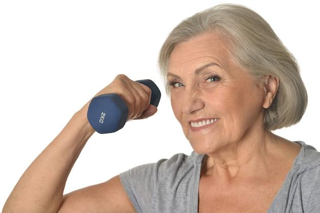Femme aînée, exercisme, à, haltère, blanc, fond