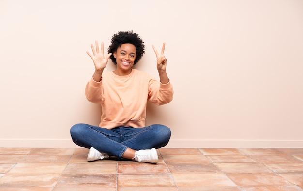 Femme américaine africaine, séance terre