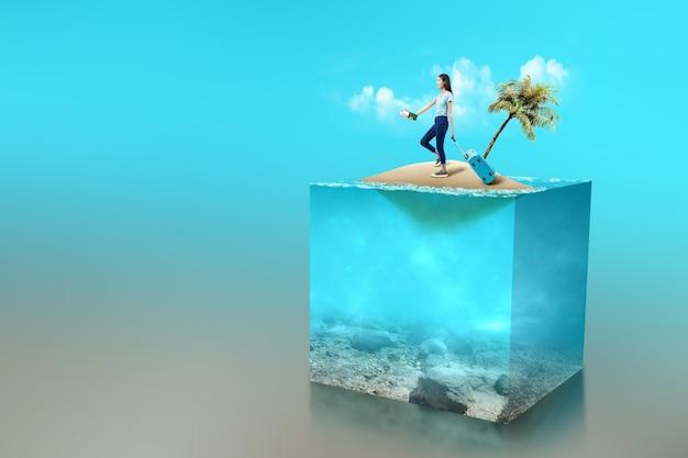 Femme asiatique avec une valise tenant un billet et un passeport sur une petite île avec une vue sous-marine de l'eau bleue sur l'océan. notion d'environnement
