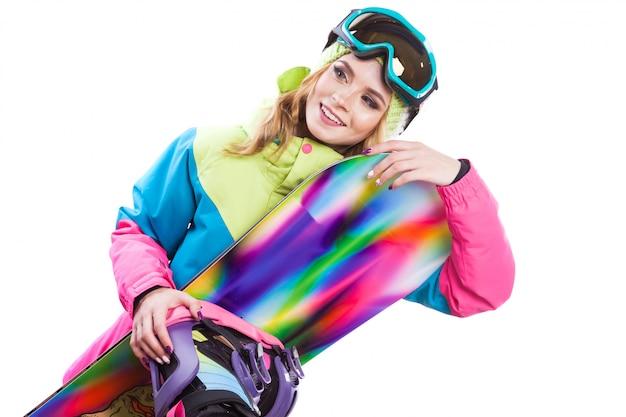 Femme blonde tenir snowboard