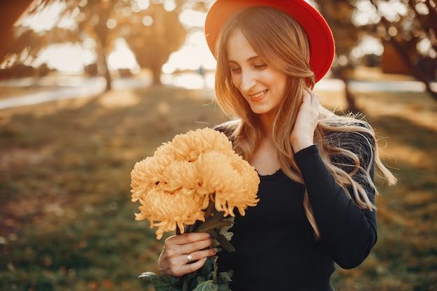 Femme avec bouquet de fleurs