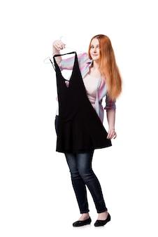 Femme, choix, vêtements, magasin, isolé, blanc