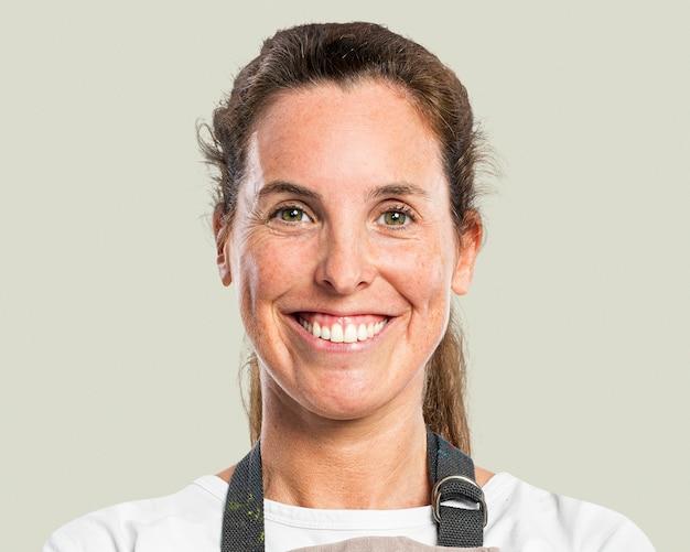 Femme confiante, propriétaire d'entreprise portant un portrait de visage de tablier