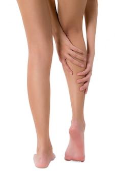 Femme, derrière, vue, tenue, elle, jambe, à, masser, mollet, dans, douleur, zone, isolé, blanc