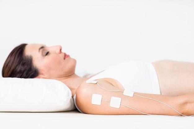 Femme, électrothérapie