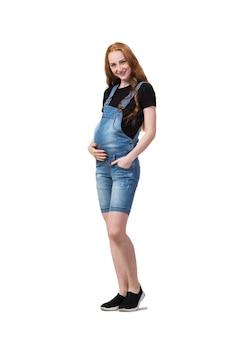 Femme enceinte isolée sur le blanc