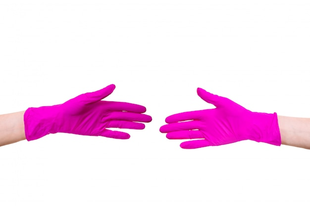 Femme garder porter gros plan des gants médecin hospice rose infirmière mains blanc isolé médical client poignée de main
