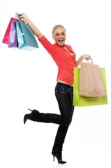 Femme heureuse, à, coloré, sacs provisions