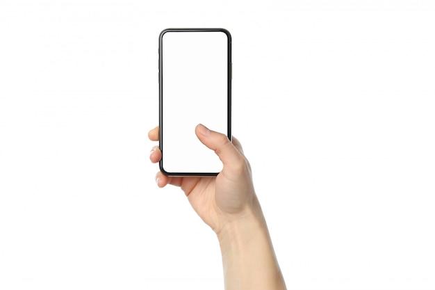 Femme main tenant le téléphone avec écran vide, isolé sur fond blanc