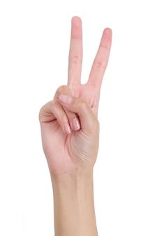 Femme mains gesticulant signe victoire par côté avant isolé sur blanc