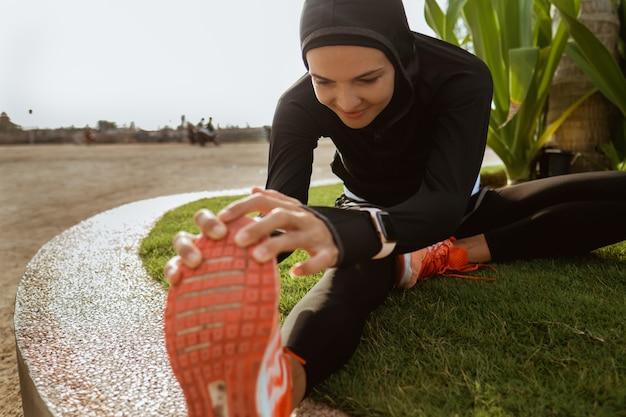 Femme, musulman, sport, usure, étirage