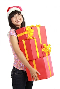 Femme noël, tenue, cadeaux, porter, santa chapeau
