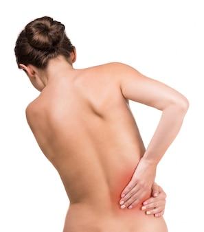 Femme nue avec douleur dans le dos