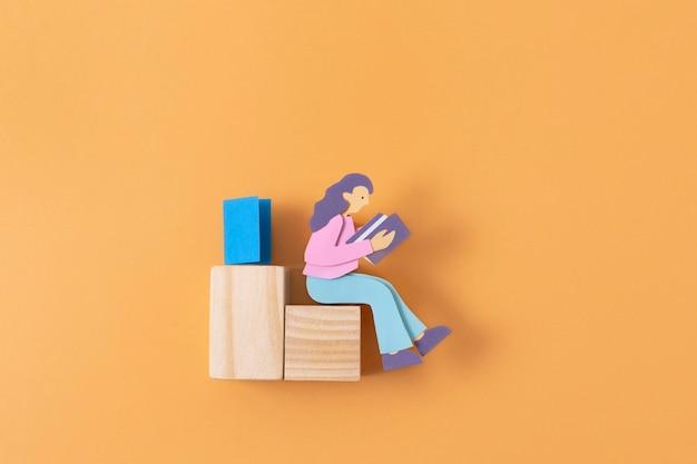 Femme en papier vue de dessus avec des morceaux de bois