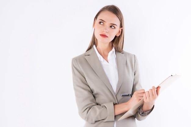 Femme qui travaille, écrire une note