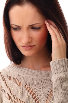 Femme avec stress ou maux de tête