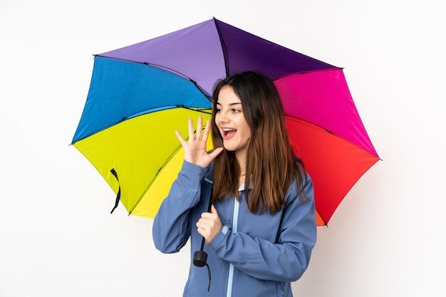 Femme tenant un parapluie