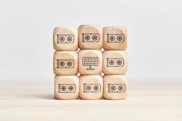 Ferme crypto abstraite à partir de cartes vidéo avec des icônes sur des cubes en bois.