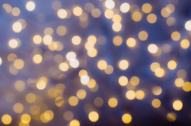Festif fond avec des lumières de bokeh. noël et nouvel an