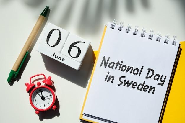 Fête nationale en suède 06 sixième juin mois calendrier concept sur des blocs de bois.