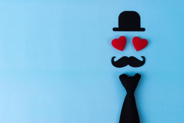 Fête des pères, chapeau noir, moustache et deux coeurs rouges