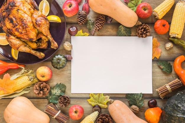 Feuille blanche entre la composition de légumes