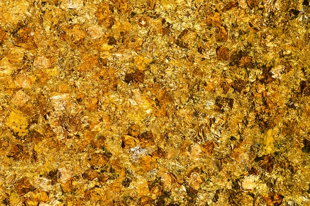 Feuille d'or jaune brillant ou morceaux de fond de feuille d'or