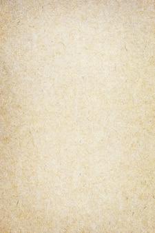 Feuille de papier brun ou texture de carton pour mur.
