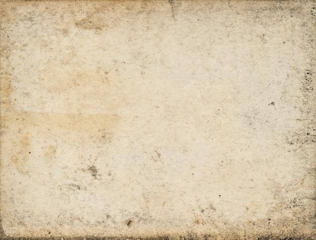 Feuille de papier usagée. texture carton sale