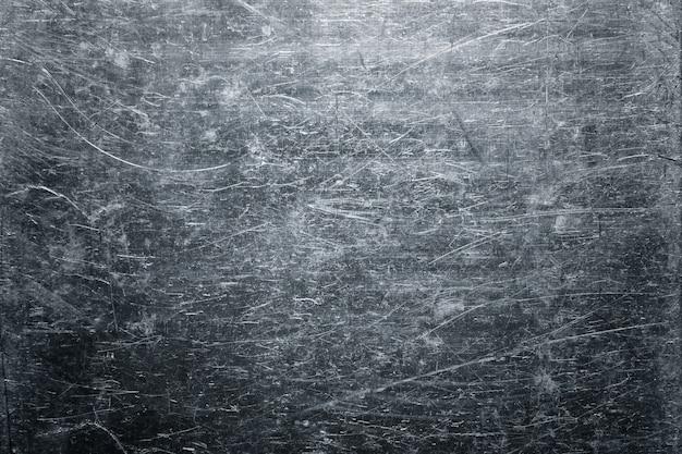 Feuille tordue de texture métallique ancienne, fond de plaque d'acier patiné