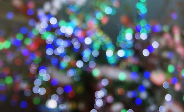 Feuilles abstraites bokeh glitter vintage. christmas bokeh light defocused abstract background.can peut être utilisé texture de fond d'écran avec espace d'espace de copie pour un texte