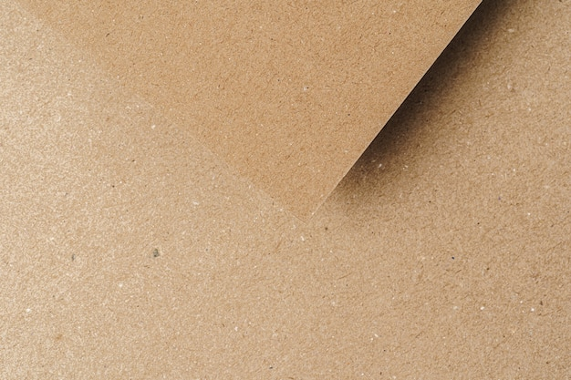 Les feuilles de papier cartonné recyclé brun se bouchent. concept d'entreprise