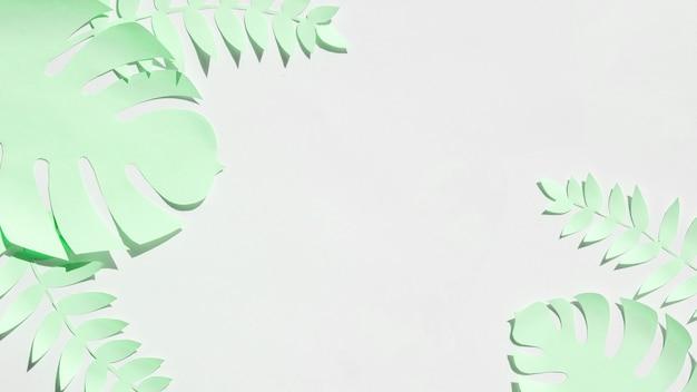 Feuilles tropicales en papier style coupé en gris