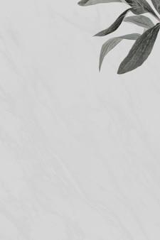 Feuilles vertes sur fond de marbre gris