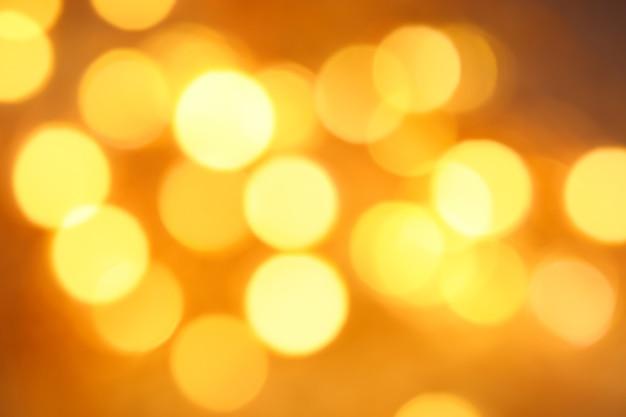Feux dorés défocalisés abstrait bokeh texture festive de fond