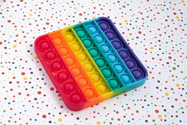 Fidget Pop It Toy Couleur Arc-en-ciel - Antistress, Amusant Et éducatif Photo gratuit