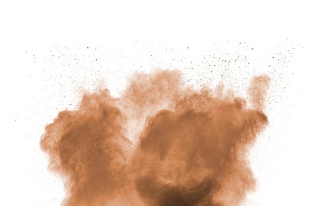 Figer le mouvement de l'explosion de poussière brune.