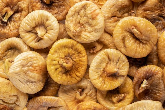 Figues séchées, vue du dessus. fond de texture pour des articles sur une alimentation saine et un mode de vie approprié.