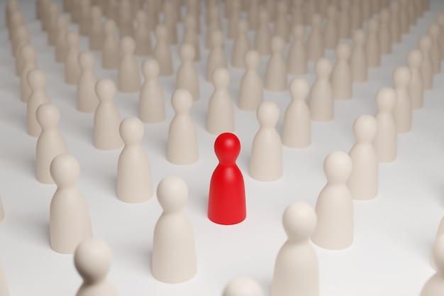 Figure de pion rouge entourée de pions blancs. mise au point sélective. concept de différence.