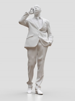 Figure en plastique d'homme noir en costume parlant au téléphone