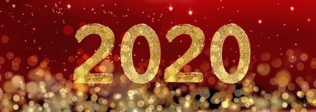 Figures du nouvel an doré 2020 sur flou de lumières et fond rouge