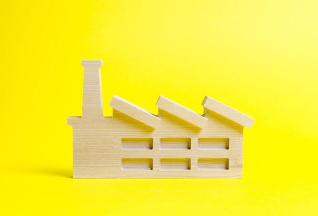Figurine en bois d'une usine ou d'une usine