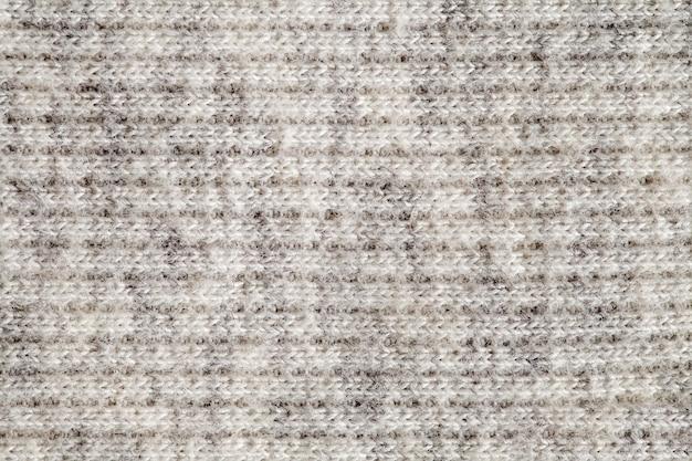 Fil de laine fait de fils blancs, structure d'arrière-plan, vue macro en gros plan